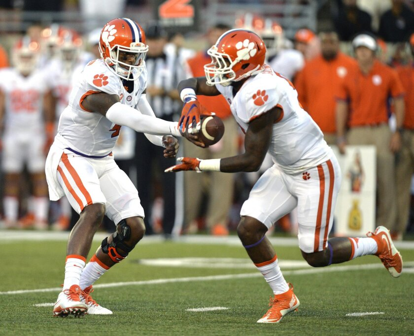 FILE - In this Sept. 17, 2015 file photo, Clemson quarterback Deshaun Watson, left, hands the ball off to Wayne Gallman during the first half of an NCAA college football game against Louisville in Louisville, Ky. Clemson takes on No. 6 Notre Dame this Saturday, Oct. 3, in a matchup between two undefeated teams. (AP Photo/Timothy D. Easley)