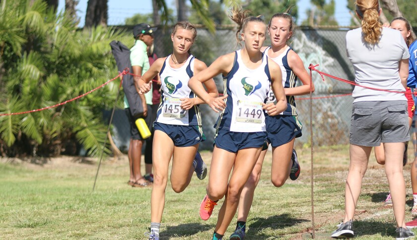 LCC's Kyra Compton (center) with teammates Rebekah Niednagel (left) and Georgia Patyna (right) early in Saturday's race.