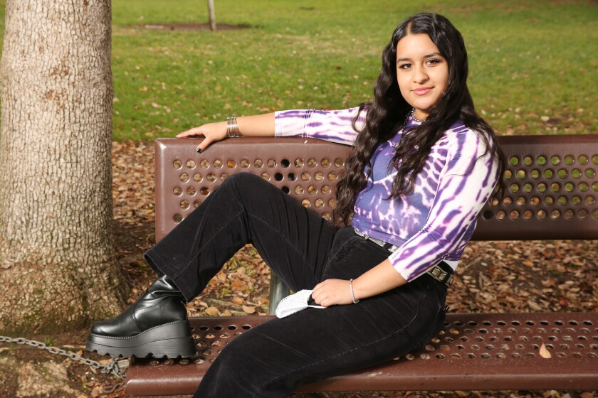 Sheccid Vazquez wears a mix of new and vintage items at Michigan Park in Whittier.