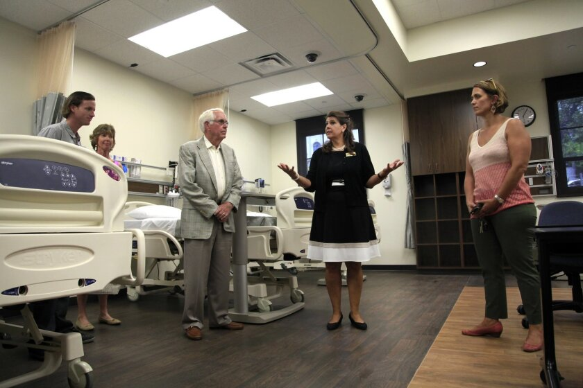 Dr. Karen Macauley gives guests a tour of the new facility.