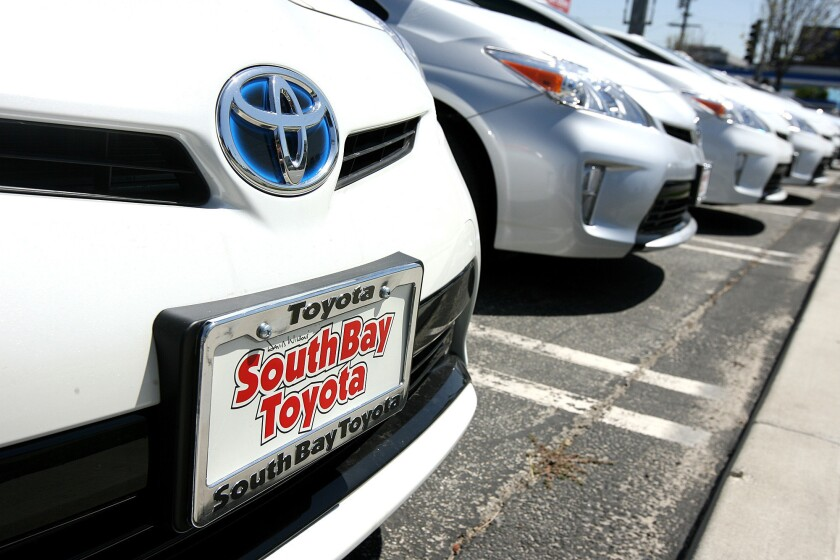 A row of new Toyota Priuses parked across the street from Toyota's U.S. headquarters in Torrance on Monday.