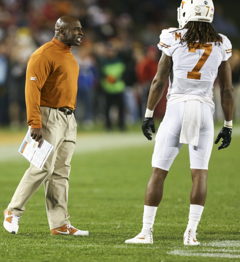 Texas head coach Charlie Strong yells at his defense during the second half of an NCAA college football game against Iowa State, Saturday, Oct. 31, 2015, in Ames, Iowa. Iowa State won 24-0. (AP Photo/Justin Hayworth)