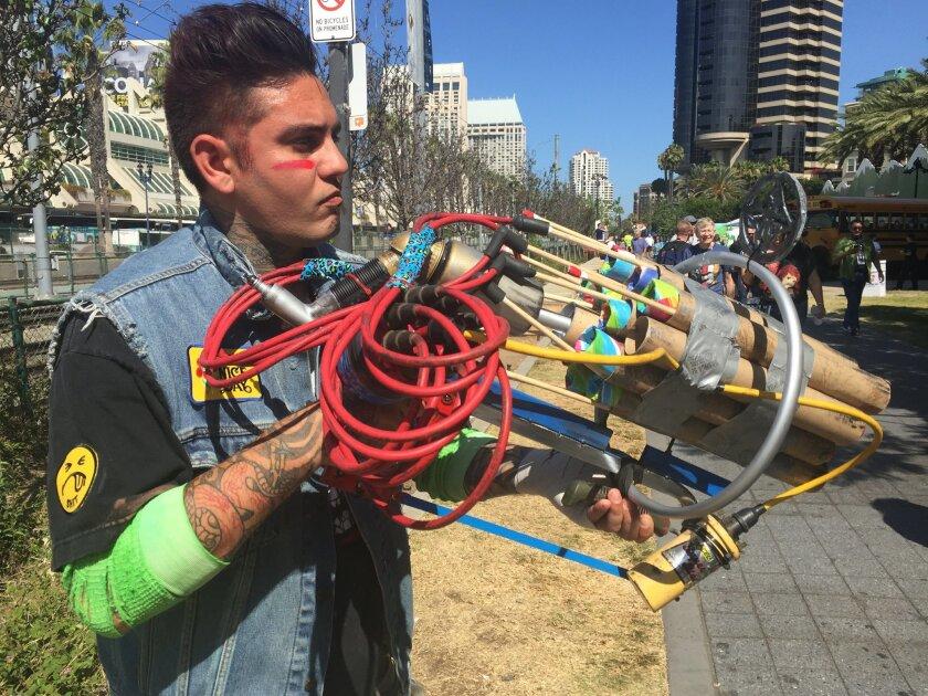 "David Arambula of Hermosa Beach, California holds up a ""Roman candle gun"" he built himself."