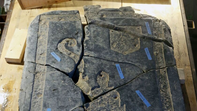 A portion of the 6-foot black stone slab rediscovered in the 1617 church is seen in historic Jamesto