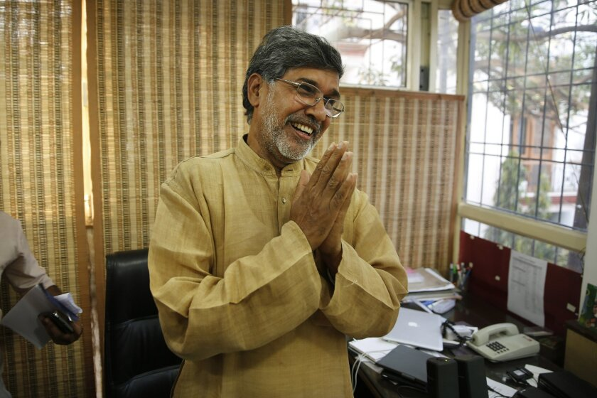 Indian children's rights activist Kailash Satyarthi gestures as he addresses the media at his office in New Delhi, India, Friday, Oct. 10, 2014. Malala Yousafzai of Pakistan and Satyarthi of India jointly won the Nobel Peace Prize on Friday, Oct. 10, 2014, for risking their lives to fight for children's rights. (AP Photo/Manish Swarup)