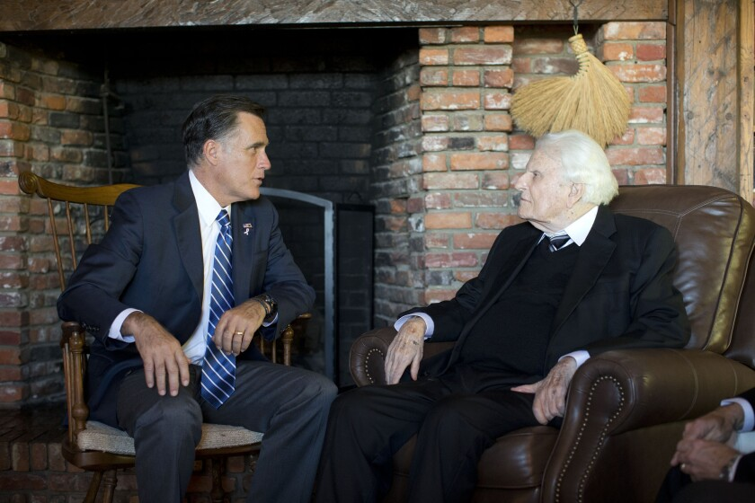Republican presidential candidate Mitt Romney meets with Rev. Billy Graham, in Montreat, N.C. The Billy Graham Evangelistic Assn. has now removed Mormonism from its list of religious cults.