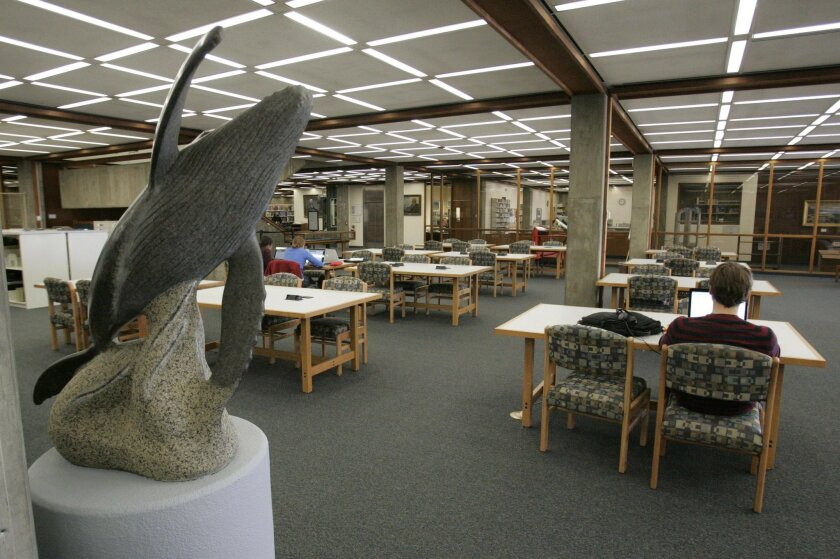 The Scripps Institution of Oceanography library is in danger of being shuttered due to budget problems. A granite gray whale sculpture in the first floor area.