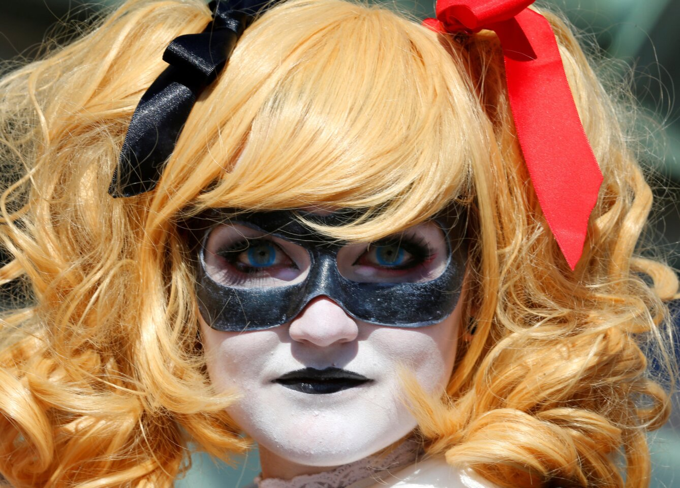 Em Blackburn from Atlanta, Georgia arrives dressed as Harley Quinn for opening day of the annual Comic-Con International in San Diego, California