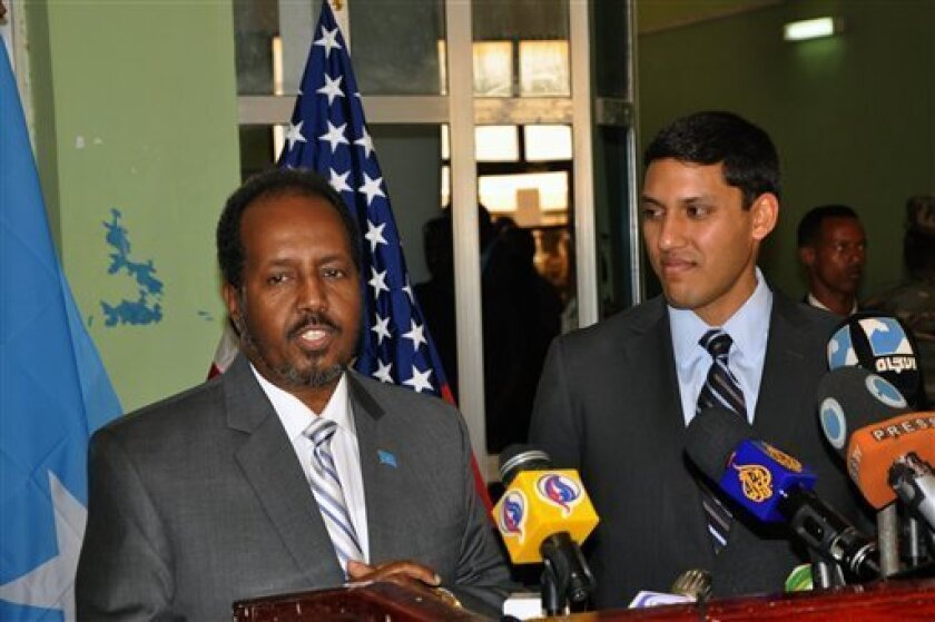 Somali President, Hassan Sheikh Mohamud, left and the USAID administrator Rajiv Shah, right, at a joint press conference at Mogadishu airport, Somalia, Thursday, Feb. 21, 2013. Shah who made the first visit by a high ranking US administration official for years in Somalia has announced $20 million