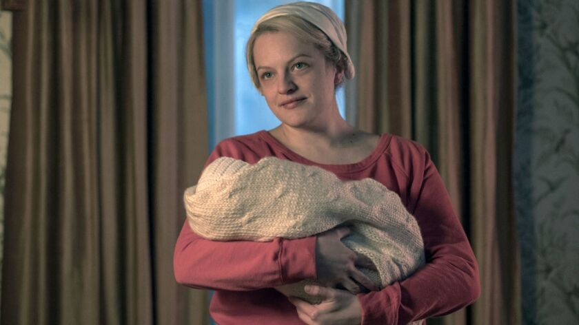 "This image released by Hulu shows Elisabeth Moss in a scene from ""The Handmaid's Tale."" On Thursday,"
