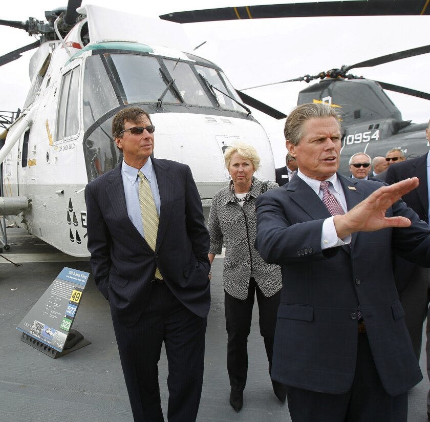 Cox Enterprises Chairman Jim Kennedy, left, announced $1.5 million grant to the USS Midway Museum, the largest grant in its history  on Monday. Kennedy is shown here getting a tour from Mac McLaughlin President & CEO of the USS Midway Museum.
