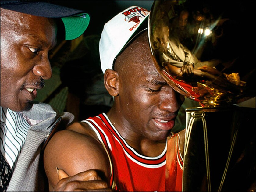 Michael Jordan celebrates with his father in the locker room after the Chicago Bulls won Game 5 of the 1991 NBA Finals.