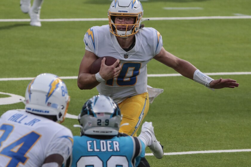 Chargers quarterback Justin Herbert scrambles for a first down during the fourth quarter of a 21-16 loss.