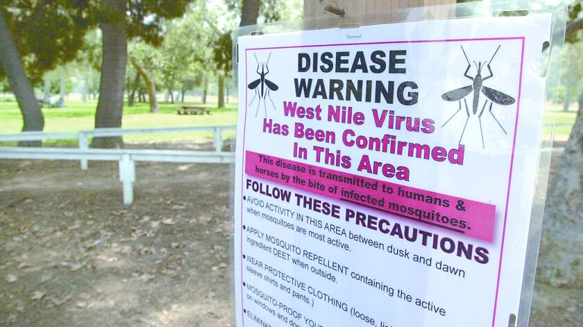West Nile Virus warning signs posted near the horse trails of the LA Equestrian Center