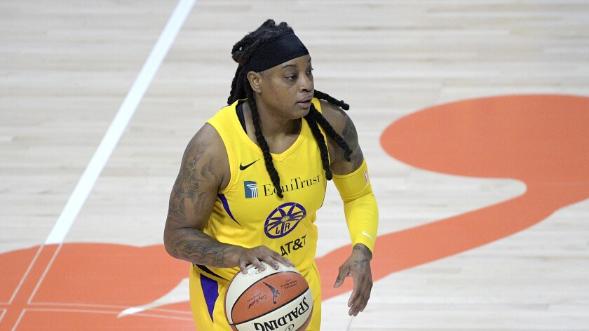 Sparks guard Riquna Williams controls the ball.
