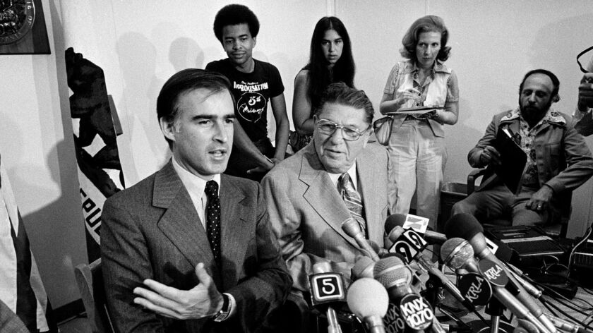 Gov. Jerry Brown and anti-tax advocate Howard Jarvis hold a Los Angeles news conference to discuss Proposition 13 on July 19, 1978.