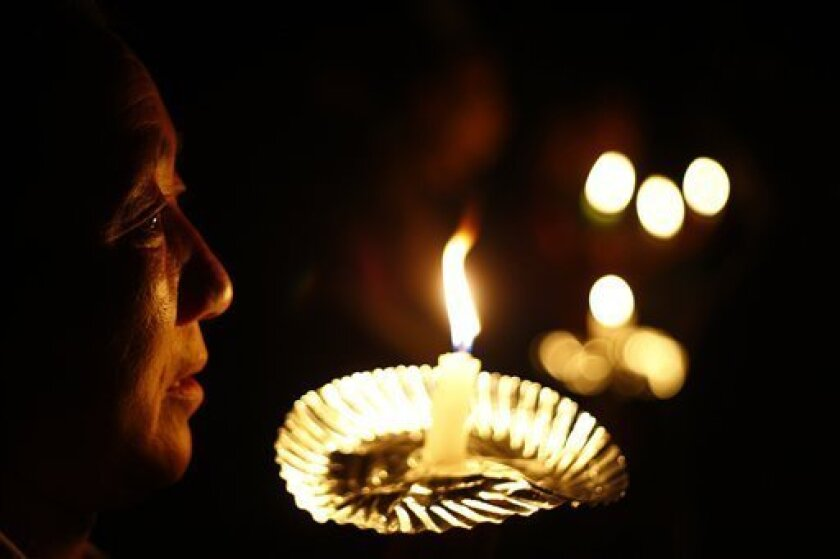 Exile Tibetans pay tribute to the Tibetans who died in the recent self-immolation protests against the Chinese government as they hold candles in Katmandu, Nepal, Tuesday, Oct. 11, 2011. Five Tibetans have set themselves on fire in southwest China's Sichuan province in the past two weeks. (AP Photo/Niranjan Shrestha)