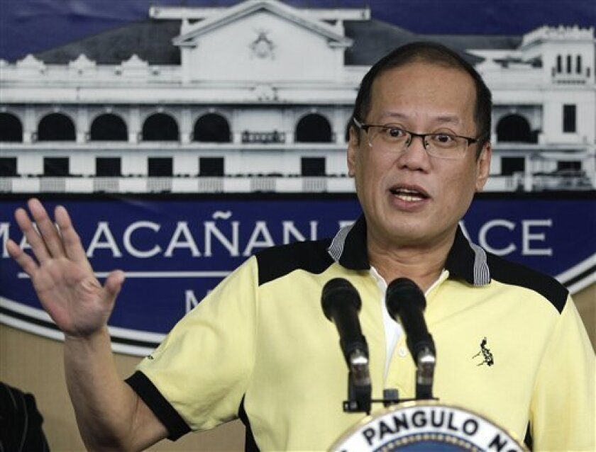 Philippine President Benigno Aquino III gestures as he answers questions from reporters at the Malacanang Presidential Palace in Manila, Philippines on Tuesday, Feb. 26, 2013. Aquino has asked royal Muslim clan leader Sultan Jamalul Kiram III to order his followers to leave Malaysian land they claim as their own as soon as possible. (AP Photo/Aaron Favila)
