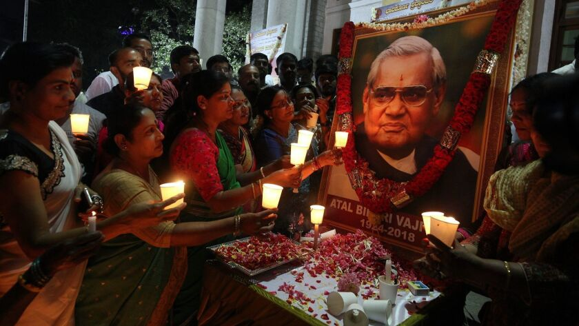 People pay tribute to former Indian Prime Minister Atal Bihari Vajpayee in Bangalore, India, on Aug. 17, 2018. Vajpayee died Aug. 16.