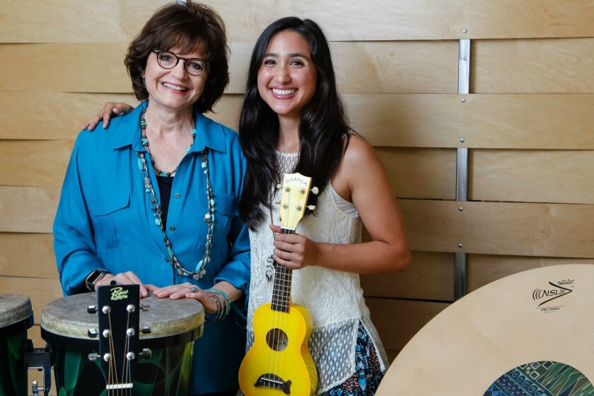 Barbara Reuer (left), founder and CEO of Resounding Joy Inc., and Megan Wong, director of Semper Sound, show instruments they use in their music therapy.