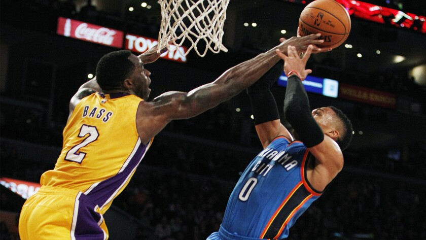 Lakers forward Brandon Bass (2) blocks a shot by Thunder guard Russell Westbrook (0) in the second half.