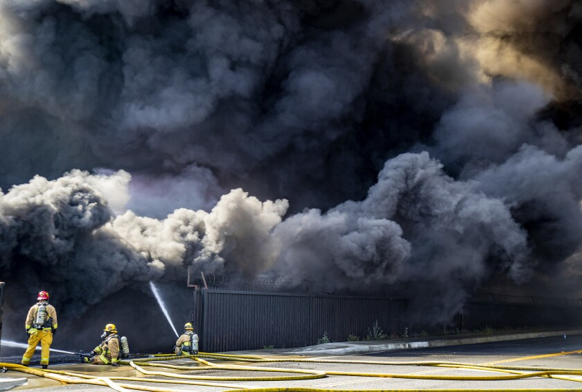 ONTARIO, CA - APRIL 30, 2019: Thick black smoke fills the air as Ontario firefighters try to put out