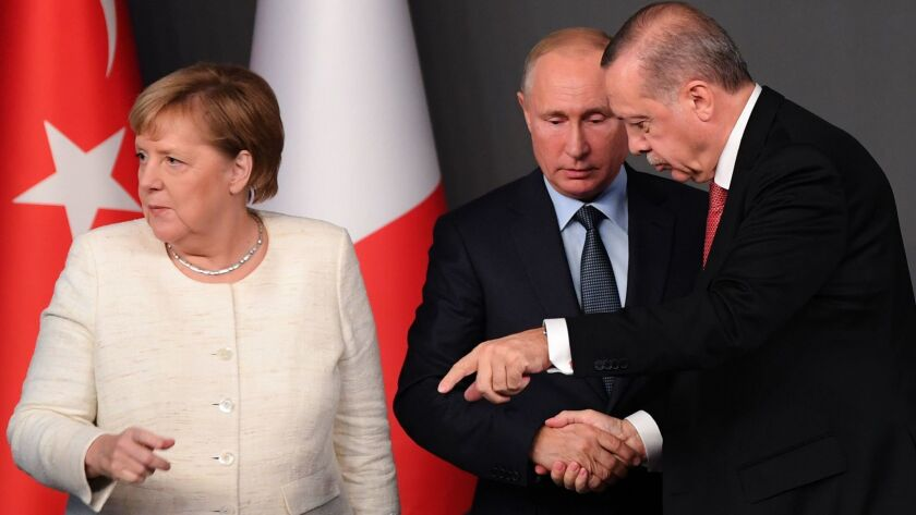 German Chancellor Angela Merkel, Russian President Vladimir Putin and Turkish President Recep Tayyip Erdogan during a conference at a summit called to attempt to find a lasting political solution to Syria's civil war. The summit was in Istanbul, Turkey, on Oct. 27, 2018.