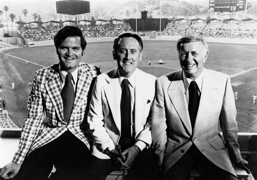Vin Scully, center, poses for a photo with broadcast partners Ross Porter, left, and Jerry Doggett in April 1978.