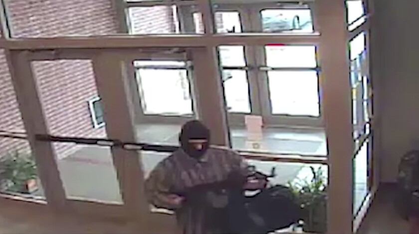 """An image from surveillance video shows the suspect known as the """"AK-47 Bandit."""" Richard Gathercole, a Montana man federal officials suspect is the serial bank robber, is in custody in Nebraska."""