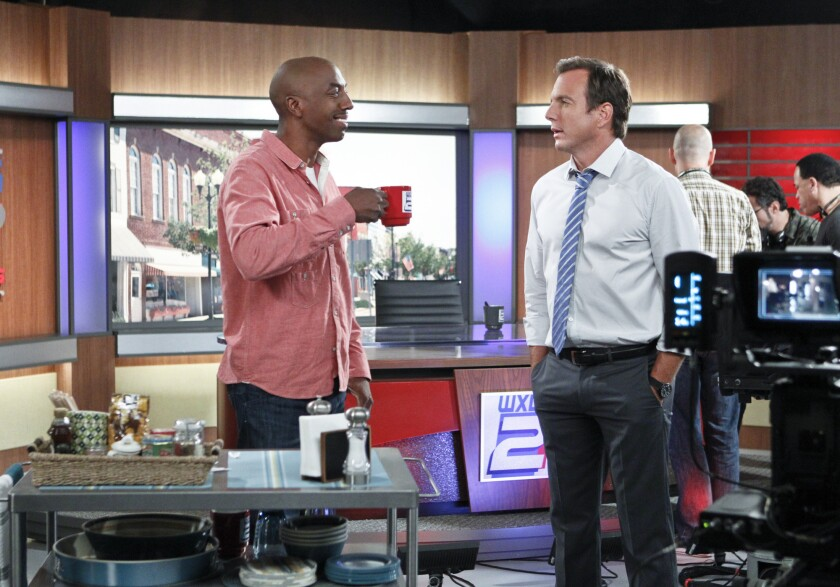 """J.B. Smoove and Will Arnett in """"The Millers."""""""