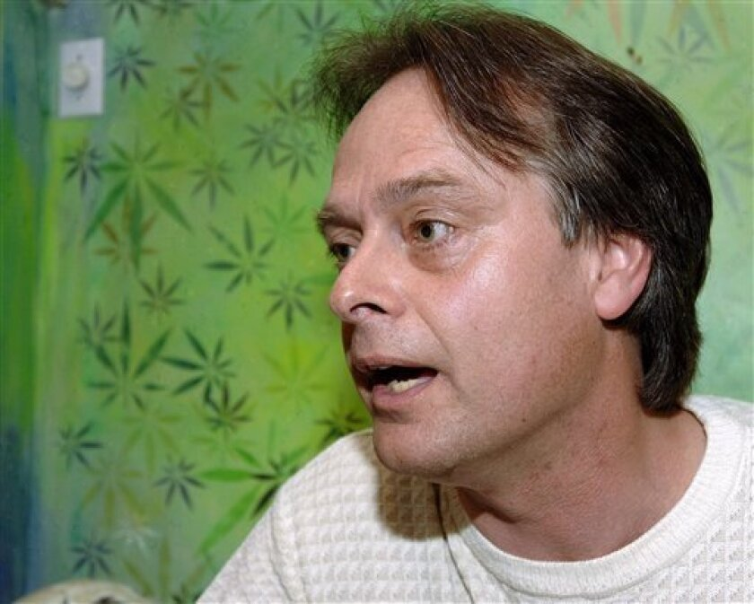 "FILE - In this Aug. 5, 2005 file photo, British Columbia Marijuana Party leader Marc Emery speaks with members of the media in Vancouver. For more than a decade, Marc Emery sold millions of marijuana seeds around the world by mail, going so far as to tag himself ""The Prince of Pot."" (AP Photo/The C"