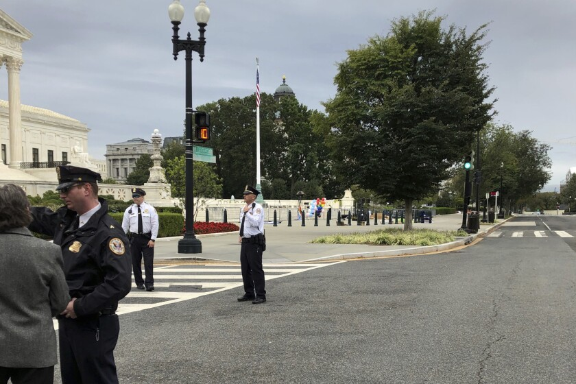 The streets outside the front of the Supreme Court are closed off for a suspicious package, Tuesday morning, Oct. 8, 2019 in Washington. (AP Photo/Mark Sherman)