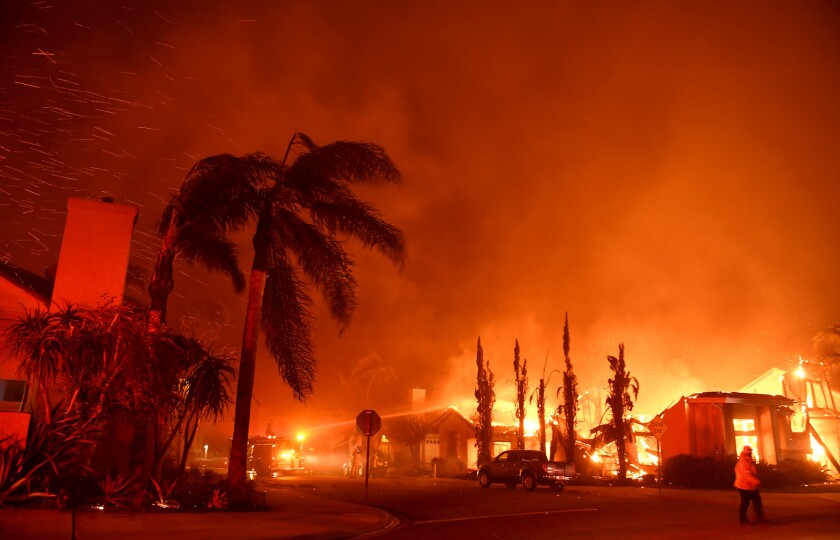 Flames rage on Churchwood Drive as the Woolsey fire tears through Oak Park.