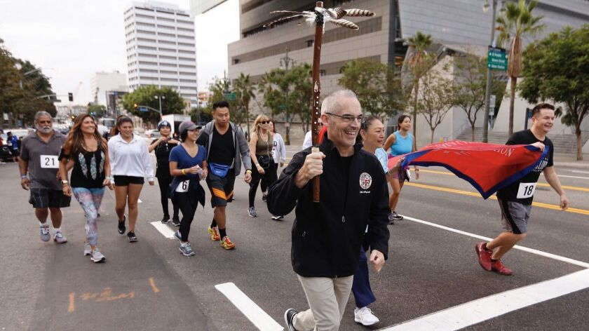 LOS ANGELES CA OCTOBER 8, 2018 -- LA City Councilman Mitch O'Farrell holds the ceremonial running