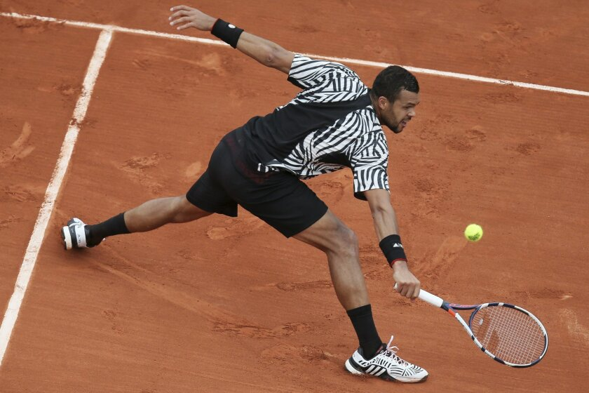 France's Jo-Wilfried Tsonga returns in his second round match of the French Open tennis tournament against Marcos Baghdatis of Cyprus at the Roland Garros stadium in Paris, France, Thursday, May 26, 2016. (AP Photo/David Vincent)