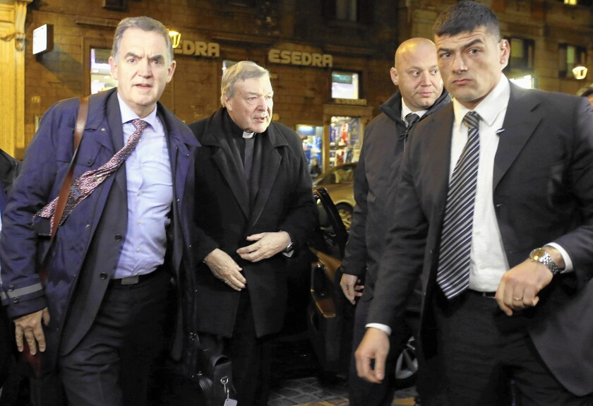 Australian Cardinal George Pell, second from left, arrives at a hotel in Rome on March 2 to testify via video link to the Royal Commission Into Institutional Responses to Child Sexual Abuse sitting in Sydney, Australia.