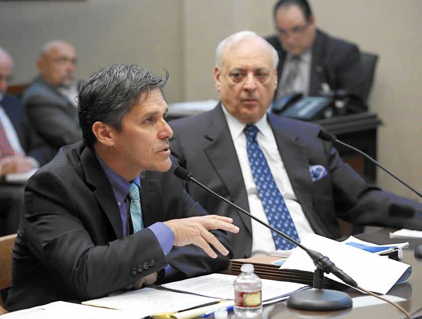 California High-Speed Rail Authority Chief Executive Jeff Morales, left, discusses the bullet train project at a legislative hearing. With him is Chairman Dan Richard.