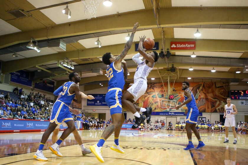 UCLA forward Shareef O'Neal stays in front of Chaminade guard Kendall Small as he shoots during a game Nov. 26 at the Maui Invitational.