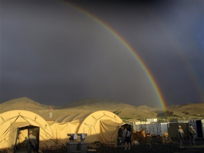 In this June 16, 2010 handout photo provided by the U.S. Army, a general view of a rainbow after a good rain shower at Combat Outpost Sayed Abad, Wardak province, Afghanistan. Nearly 80 American soldiers were wounded and two Afghan civilians were killed in a Taliban truck bombing targeting the American base in eastern Afghanistan, NATO said Sunday, a stark reminder that the war in Afghanistan still rages 10 years after the Sept. 11 terror attacks against the United States. The blast, which occurred late Saturday, Sept. 10, 2011, shaved the facades from shops outside the Combat Outpost Sayed Abad in Wardak province and broke windows in government offices nearby, said Roshana Wardak, a former parliamentarian who runs a clinic in the nearby town of the same name. The Taliban claimed responsibility for the attack. (AP Photo/Sean McKenna/U.S. Army,HO)