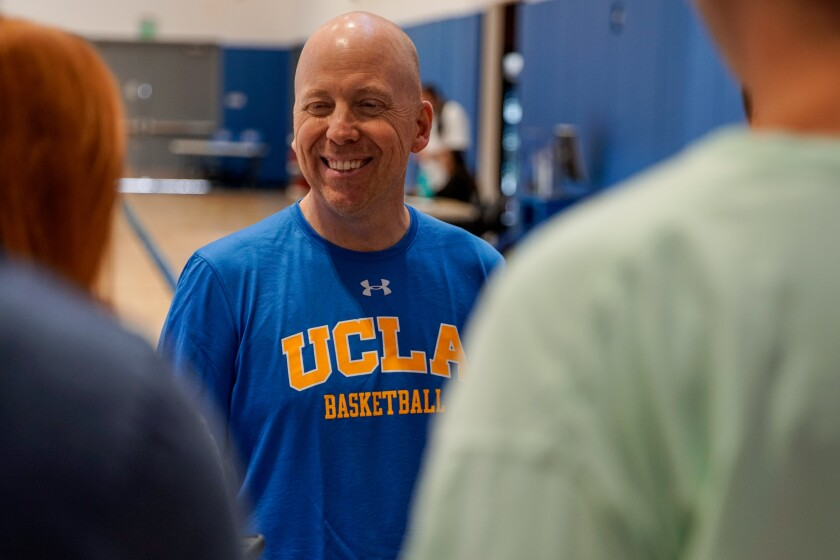 UCLA Bruins head coach Mick Cronin speaks with reporters before practice at the Mo Ostin Basketball Center on in Westwood.