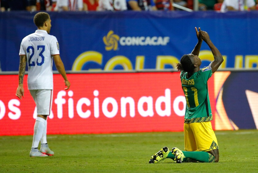 ATLANTA, GA - JULY 22: Darren Mattocks #11 of Jamaica celebrates scoring the opening goal against the United States of America during the 2015 CONCACAF Golf Cup Semifinal match between Jamaica and the United States at Georgia Dome on July 22, 2015 in Atlanta, Georgia. (Photo by Kevin C. Cox/Getty Images) ** OUTS - ELSENT, FPG - OUTS * NM, PH, VA if sourced by CT, LA or MoD **
