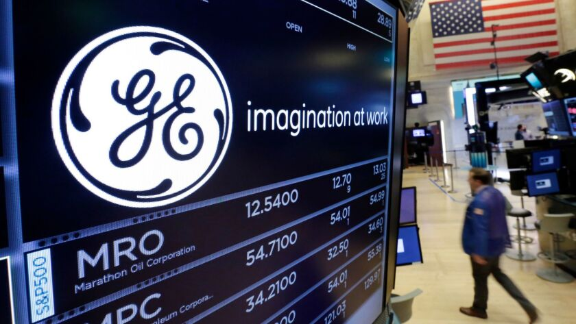 The General Electric logo is displayed on the floor of the New York Stock Exchange in June.