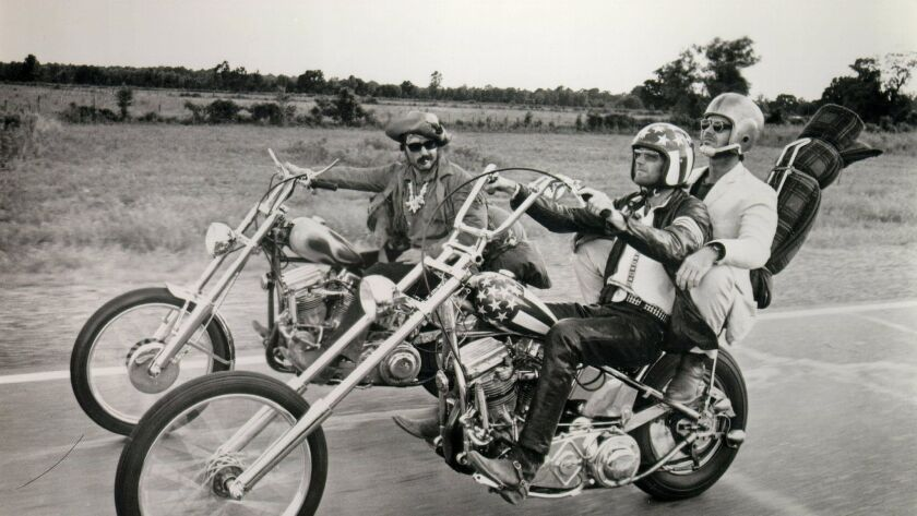 """Helix High graduate Dennis Hopper (left). Peter Fonda and Jack Nicholson are shown in a scene from the hit 1969 movie """"""""Easy Rider,"""" which is spoofed in the Coen Brothers' new Mercedes-Benz commercial."""