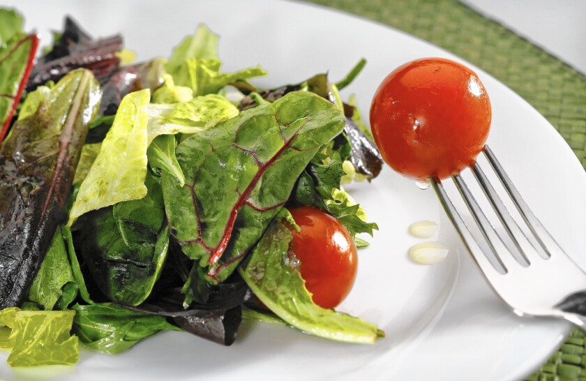 Professor Traci Mann recommends eating a salad or vegetable before a meal as a way to eat less and lose weight.
