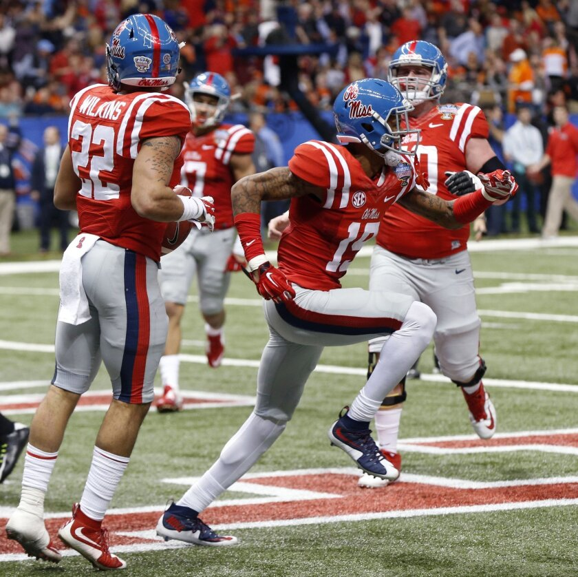 Mississippi running back Jordan Wilkins (22) celebrates his touchdown carry with wide receiver Derrick Jones (19) in the second half of the Sugar Bowl college football game against Oklahoma State in New Orleans, Friday, Jan. 1, 2016. (AP Photo/Bill Feig)