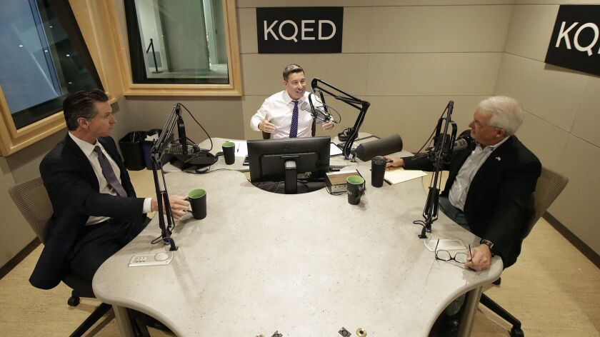 Radio host Scott Shafer, center, speaks before moderating a California gubernatorial debate between Democratic candidate Gavin Newsom, left, and Republican candidate John Cox at KQED's studio in San Francisco on Monday.