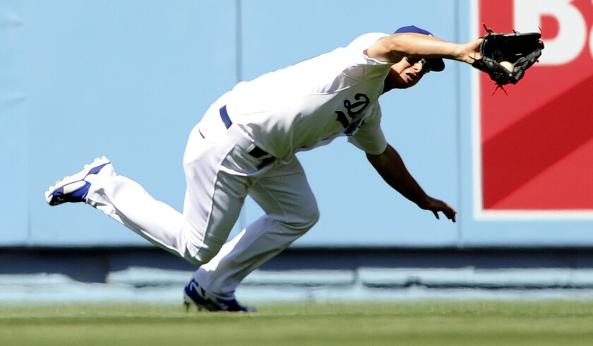 Dodgers center fielder Joc Pederson makes a diving catch on a ball hit by Padres third baseman Will Middlebrooks during the season opener on April 6.