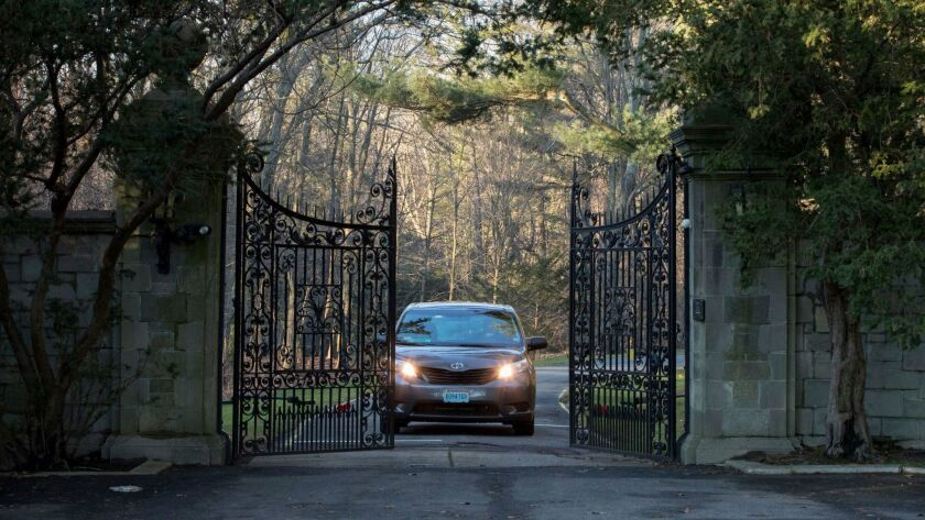 Cars with diplomatic plates drive out of a compound near Glen Cove, N.Y., on Long Island on Friday, Dec. 30, 2016.