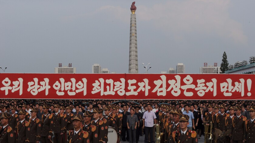 Participants stand behind a military band during a celebration rally following the country's successful test of a nuclear warhead in Pyongyang on Sept. 13.