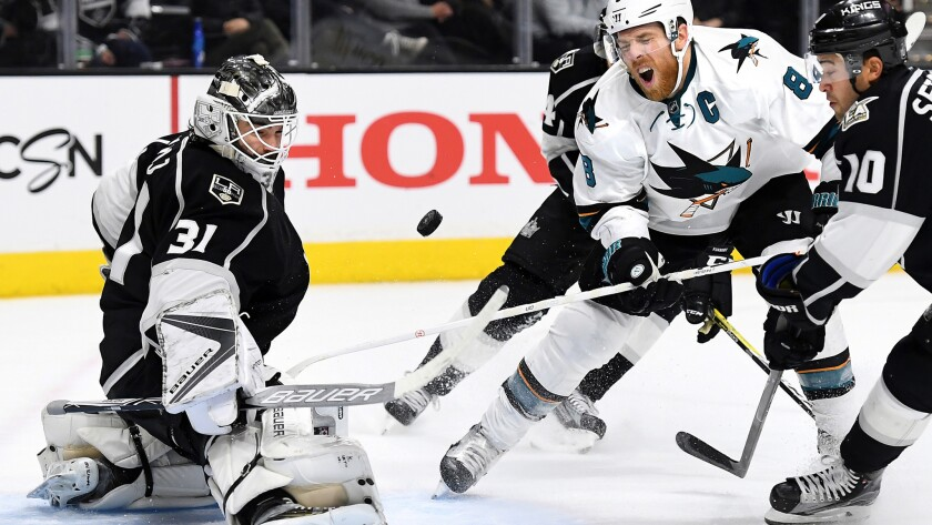 Kings goalie Peter Budaj makes a save against Sharks captain Joe Pavelski during the second period Wednesday night at the Staples Center.